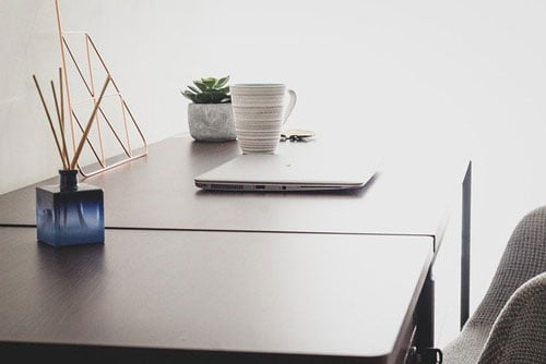 Minimalist Table with Laptop on it